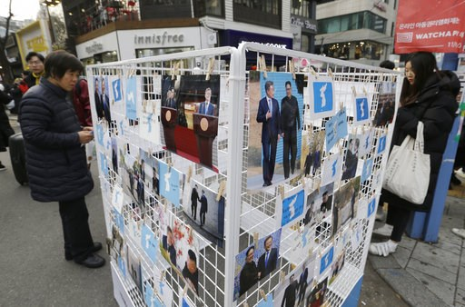 (AP Photo/Ahn Young-joon, File). FILE - In this Nov. 25, 2018, file photo, photos of South Korean President Moon Jae-in and North Korean leader Kim Jong Un and unification flags are displayed during a campaign to welcome Kim's possible visit to the Sou...