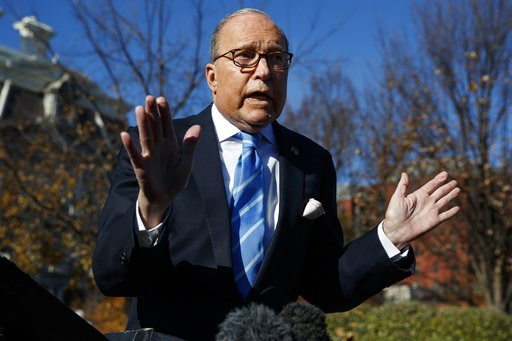 (AP Photo/Evan Vucci). White House chief economic adviser Larry Kudlow talks with reporters about trade negotiations with China, at the White House, Monday, Dec. 3, 2018, in Washington.