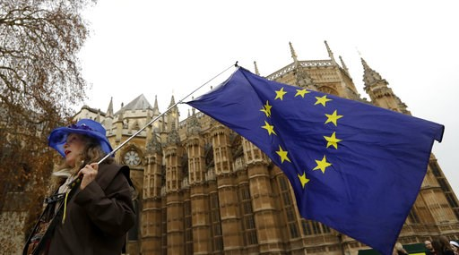 (AP Photo/Kirsty Wigglesworth). An Anti Brexit campaigner waves a European Union flag in Westminster in London, Tuesday, Dec. 4, 2018. Britain's Prime Minister Theresa May is due to address Parliament Tuesday, opening five days of debate before a Dec. ...