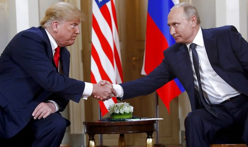 (AP Photo/Pablo Martinez Monsivais). U.S. President Donald Trump, left, and Russian President Vladimir Putin shake hands at the beginning of a meeting at the Presidential Palace in Helsinki, Finland, on July 16, 2018.