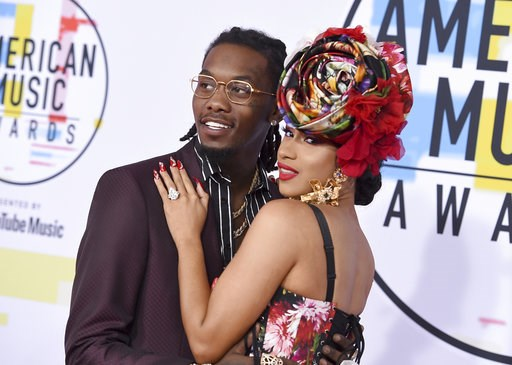 (Photo by Jordan Strauss/Invision/AP, File). FILE - In this Oct. 9, 2018, file photo, Offset, left, and Cardi B arrive at the American Music Awards at the Microsoft Theater in Los Angeles. Cardi B is no longer feeling the love after little more than a ...