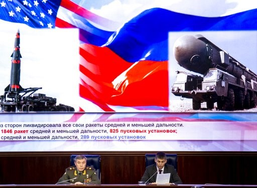 (AP Photo/Alexander Zemlianichenko). Deputy Chief of General Staff of Russia Valery Gerasimov, left, delivers his speech during a briefing in the Russian Defense Ministry's headquarters in Moscow, Russia, Wednesday, Dec. 5, 2018. Gen. Valery Gerasimov,...