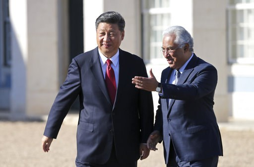 (AP Photo/Armando Franca). China's President Xi Jinping walks with Portuguese Prime Minister Antonio Costa, right, before their meeting Wednesday, Dec. 5, 2018, at the Queluz National Palace in Queluz, outside Lisbon. Xi closes Wednesday a two-day stat...