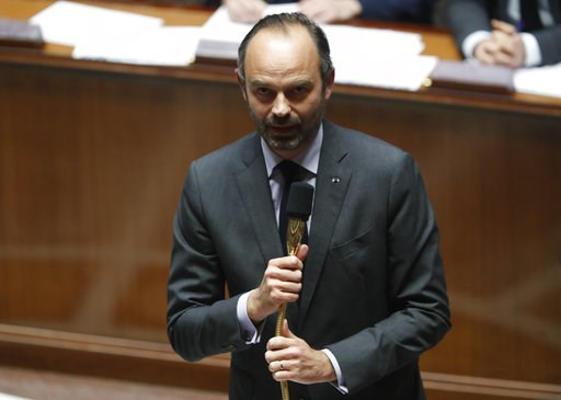 (AP Photo/Thibault Camus). French Prime Minister Edouard Philippe speaks at the National Assembly during the questions to the government session in Paris, Tuesday, Dec.4, 2018. The French government's decision to suspend fuel tax and utility hikes Tues...