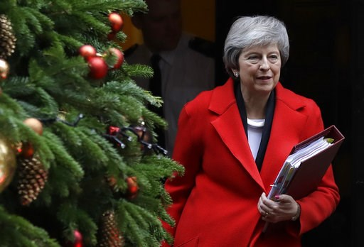 (AP Photo/Kirsty Wigglesworth). Britain's Prime Minister Theresa May leaves Downing Street in London, Wednesday, Dec. 5, 2018. Britain's Brexit debate has become a bruising battle between lawmakers and Prime Minister Theresa May's government. May is tr...