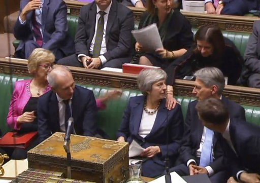 (Parliament TV/PA via AP). Britain's Prime Minister Theresa May Prime Minister Theresa May is congratulated by Conservative Party ministers in the House of Commons after speaking at the start of a five-day debate on the Brexit European Union Withdrawal...