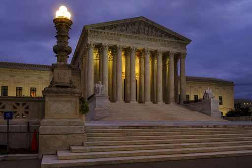 (AP Photo/J. David Ake, File). FILE - In this Oct. 5, 2018, file photo, the U. S. Supreme Court building stands quietly before dawn in Washington. The Constitution says you can't be tried twice for the same offense. And yet Terance Gamble is sitting in...