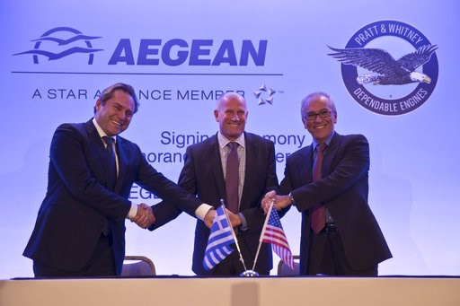 (AP Photo/Petros Giannakouris). Chairman of Aegean Airlines Eftychios Vassilakis, left, Rick Deurloo Senior Vice President - Sales, Marketing and Customer Support at Pratt & Whitney and Aegean Airlines CEO Dimitrios Gerogiannis, right, shake hands ...