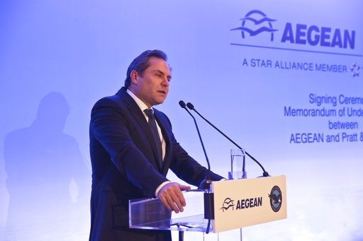(AP Photo/Petros Giannakouris). Chairman of Aegean Airlines Eftychios Vassilakis, speaks during a signing of a memorandum of understanding for the purchase of up to 130 new Pratt & Whitney engines for the Greek company's new Airbus passenger jets i...