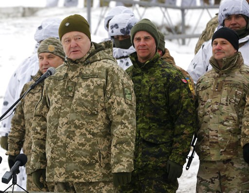 (AP Photo/Efrem Lukatsky). Ukrainian President Petro Poroshenko, second left, addresses Ukrainian soldiers as Canadian Army Lieutenant General Jean-Marc Lanthier stands at center, and commander of U.S. Army in Europe Christopher Cavoli stands right, du...