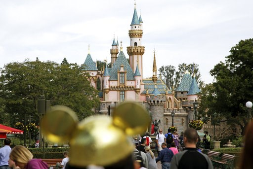 (AP Photo/Jae C. Hong, File). FILE - In this Jan. 22, 2015, file photo, visitors walk toward Sleeping Beauty's Castle in the background at Disneyland Resort in Anaheim, Calif. A health official testified that a cooling tower that provides mist to make ...
