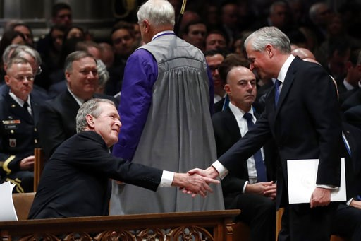 (AP Photo/Alex Brandon, Pool). Presidential biographer Jon Meacham, shakes hands with former President George Bush after speaking during the State Funeral for former President George H.W. Bush at the National Cathedral, Wednesday, Dec. 5, 2018, in Wash...