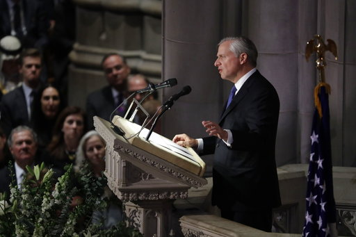 (AP Photo/Evan Vucci). Presidential biographer Jon Meacham speaks during the State Funeral for former President George H.W. Bush at the National Cathedral, Wednesday, Dec. 5, 2018, in Washington.