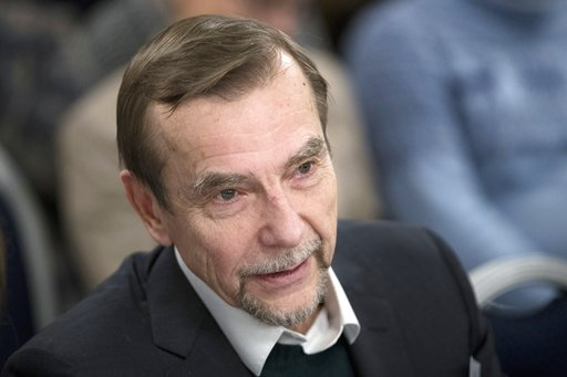 (AP Photo/Pavel Golovkin, File). FILE- In this file photo taken on Monday, Dec. 12, 2016, Russian human rights activist Lev Ponomarev attends an annual meeting of opposition and human rights activists in Moscow, Russia . A court in Moscow has sentenced...