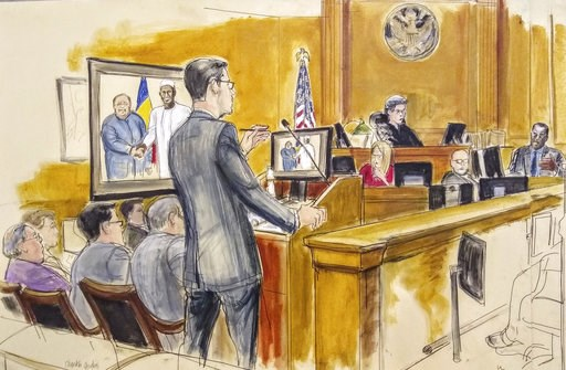 (Elizabeth Williams via AP). In this courtroom drawing, Assistant U.S. Attorney Douglas Zolkind, standing, addresses cooperating witness Cheikh Gadio, far right, during Hong Kong businessman Dr. Chi Ping Patrick Ho's bribery trial in New York, Wednesda...
