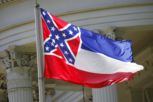 (AP Photo/Rogelio V. Solis, File). FILE - In this June 23, 2015, file photo, the state flag of Mississippi flies at the Governor's Mansion in Jackson, Miss. A federal appeals court will not revive a lawsuit that tried to block Ocean Springs, Miss., fro...