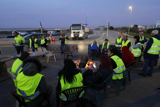 (AP Photo/Claude Paris). A group of demonstrators wearing their yellow vest occupy a traffic circle, Wednesday, Dec. 5, 2018, outside La Mede oil refinery, near Martigues, southeastern France. Trade unions and farmers pledged Wednesday to join nationwi...