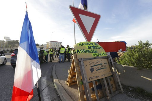 (AP Photo/Claude Paris). A group of demonstrators wearing their yellow vest occupy a traffic circle, Wednesday, Dec. 5, 2018 outside La Mede oil refinery, near Martigues, southeastern France. Trade unions and farmers pledged Wednesday to join nationwid...