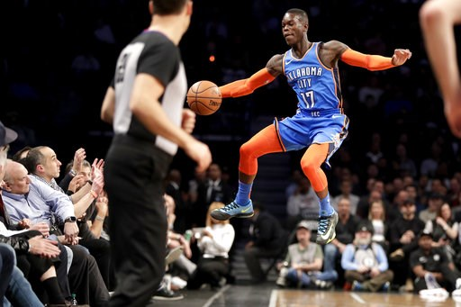 (AP Photo/Julio Cortez). Oklahoma City Thunder guard Dennis Schroder fails to keep the ball in bounds during the first half of an NBA basketball game against the Brooklyn Nets, Wednesday, Dec. 5, 2018, in New York.