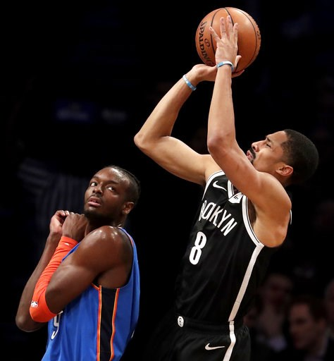 (AP Photo/Julio Cortez). Brooklyn Nets guard Spencer Dinwiddie, right, goes up for a shot against Oklahoma City Thunder forward Jerami Grant during the first half of an NBA basketball game, Wednesday, Dec. 5, 2018, in New York.