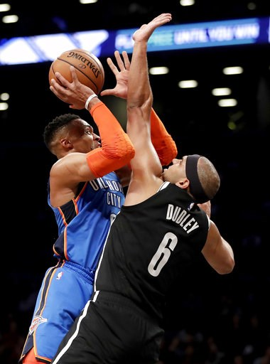 (AP Photo/Julio Cortez). Oklahoma City Thunder guard Russell Westbrook, left, goes up for a shot against Brooklyn Nets forward Jared Dudley during the first half of an NBA basketball game, Wednesday, Dec. 5, 2018, in New York.