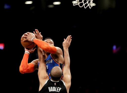 (AP Photo/Julio Cortez). Oklahoma City Thunder guard Russell Westbrook, back, goes up for a shot against Brooklyn Nets forward Jared Dudley during the first half of an NBA basketball game, Wednesday, Dec. 5, 2018, in New York.