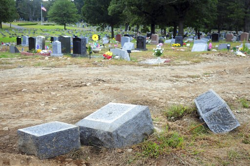 (Ned Gerard/Hearst Connecticut Media via AP, File). FILE - In this Oct. 2, 2018 file photo, toppled headstones rest on the ground in Park Cemetery in Bridgeport, Conn. A mass desecration of graves at the Connecticut cemetery has devastated dozens of fa...