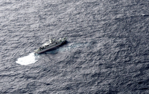 (Kyodo News via AP). In this aerial photo, Japan's Coast Guard ship is seen at sea during a search operation for U.S. Marine refueling plane and fighter jet off Muroto, Kochi prefecture, southwestern Japan, Thursday, Dec. 6, 2018. A Marine refueling pl...