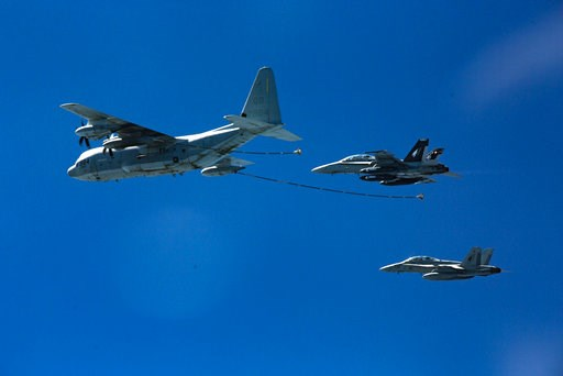 (Cpl. Trever Statz/U.S. Marine Corps via AP). In this Oct. 13, 2016, photo provided by U.S. Marine Corps, two F/A-18D Hornets with Marine All-Weather Fighter Attack Squadron 533 approach a KC-130J with Marine Aerial Refueler Transport Squadron 352 duri...