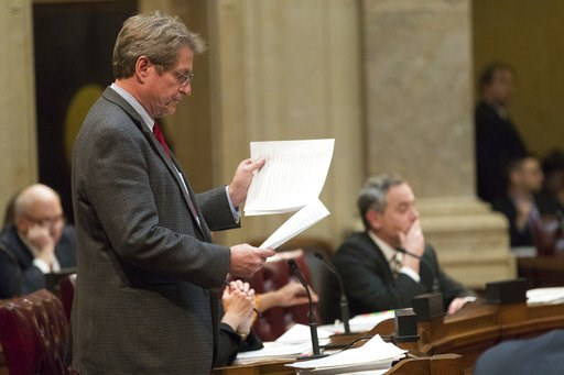 (Mark Hoffman/Milwaukee Journal-Sentinel via AP). State Sen. Tim Carpenter, left, D-Milwaukee, questions a list of about fifty appointment referrals submitted to the State Senate at the Capitol in Madison, Wis., Tuesday, Dec. 4, 2018. Demonstrators boo...