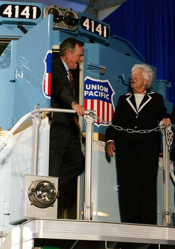 (AP Photo/Pat Sullivan, File). FILE - In this Oct. 18, 2005, file photo, former President George H.W. Bush and his wife, Barbara, tour a new locomotive numbered 4141 in honor of the 41st president at Texas A&M University in College Station, Texas. ...
