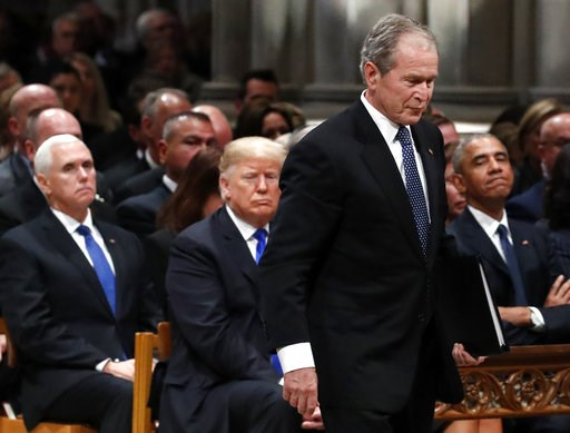 (AP Photo/Alex Brandon, Pool). Former President George W. Bush walks past President Donald Trump and former President Barack Obama to speak a State Funeral for President George H.W. Bush, at the National Cathedral, Wednesday, Dec. 5, 2018, in Washingto...