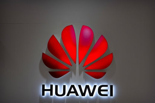 (AP Photo/Mark Schiefelbein, File). FILE - In this July 4, 2018, file photo, the Huawei logo is seen at a Huawei store at a shopping mall in Beijing. Canadian authorities said Wednesday, Dec. 5, 2018,  that they have arrested the chief financial office...