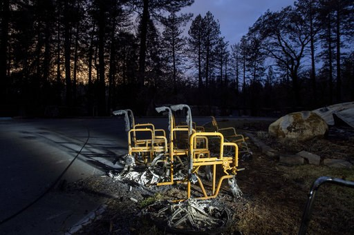 (AP Photo/Noah Berger). Scorched wheelchairs rest outside Cypress Meadows Post-Acute, a nursing home leveled by the Camp Fire, on Tuesday, Dec. 4, 2018, in Paradise, Calif.
