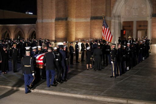 (AP Photo/Gerald Herbert). The flag-draped casket of former President George H.W. Bush is carried by a joint services military honor guard into St. Martin's Episcopal Church Wednesday, Dec. 5, 2018, in Houston.