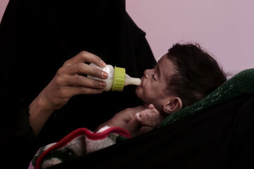 (AP Photo/Nariman El-Mofty, File). FILE - In this Feb. 13, 2018, file photo, Ahmed Rashid Mokbel, a severely malnourished 7-month-old Yemeni boy, is given formula by his mother at the Al-Sadaqa Hospital in Aden, Yemen. Envoys from Yemen's warring parti...