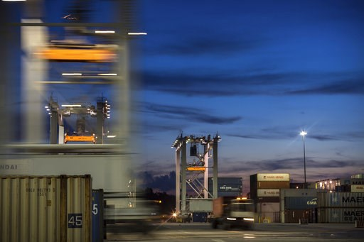 (AP Photo/Stephen B. Morton, File). In this July, 5, 2018 photo, a group of rubber tire gantry move to the next stack of shipping containers at the Port of Savannah in Savannah, Ga. On Thursday, Dec. 6, the Commerce Department reports on the U.S. trade...