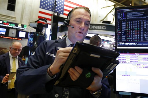 (AP Photo/Richard Drew, File). FILE- In this Nov. 28, 2018, file photo trader Jonathan Corpina works on the floor of the New York Stock Exchange. The U.S. stock market opens at 9:30 a.m. EST on Thursday, Dec. 6.