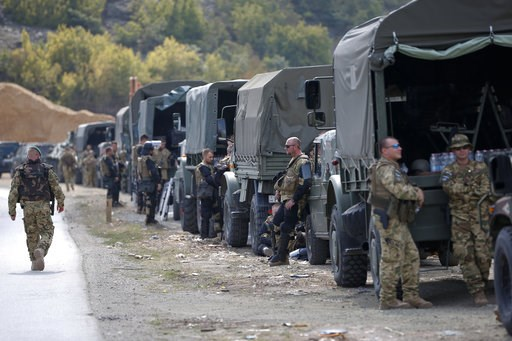 (AP Photo/Visar Kryeziu). In this photo taken on Sept. 9, 2018, soldiers of NATO-led peacekeeping force KFOR take a break by the side of the road in the village of Kosterc, Kosovo. Serbia's prime minister warned on Wednesday that the formation of a Kos...