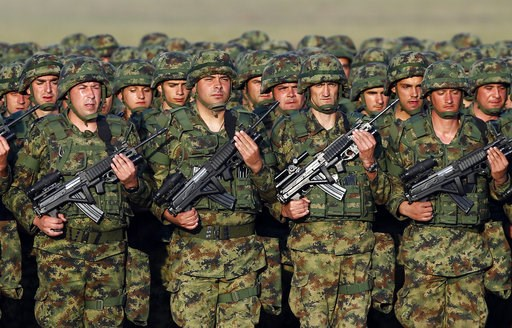 (AP Photo/Darko Vojinovic). In this photo taken on Tuesday, Oct. 17, 2017, Serbian Army soldiers perform during rehearsal exercise in Batajnica, military airport near Belgrade, Serbia. Serbia's prime minister warned on Wednesday, Dec. 5, 2018 that the ...