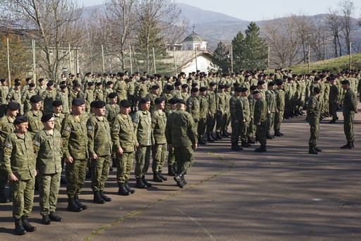 (AP Photo/Visar Kryeziu). In this photo taken  March 22, 2018, members of Kosovo Security Force (KSF) line up for the flag raising ceremony inside the barracks in the southern part of the ethnically divided town of Mitrovica, Kosovo. Serbia's prime min...