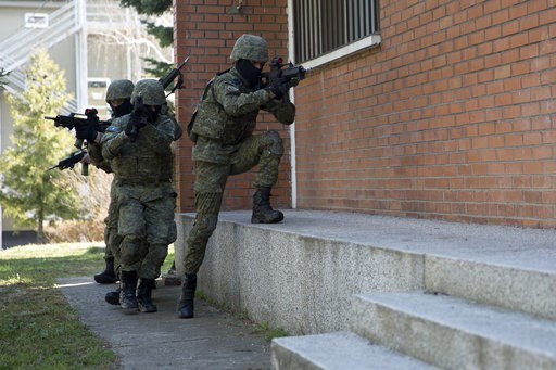 (AP Photo/Visar Kryeziu). In this photo taken March 22, 2018, members of Kosovo Security Force (KSF) train in hostage rescue situation inside the barracks in the southern part of the ethnically divided town of Mitrovica, Kosovo. Serbia's prime minister...