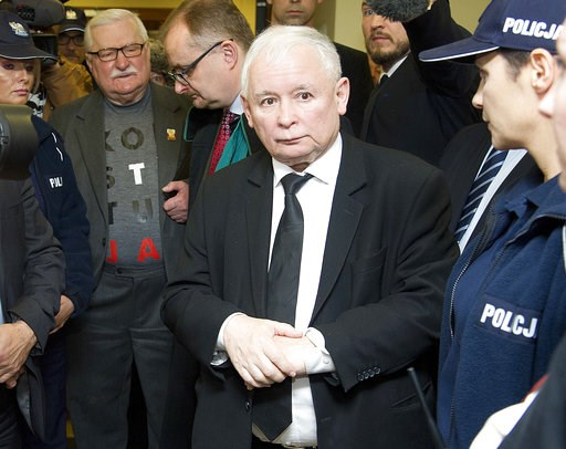 (AP Photo/Wojciech Strozyk). Poland's two most famous foes, the country's de facto leader, head of the ruling party Jaroslaw Kaczynski, right, and former President Lech Walesa, second left, stand near each other after exchanging wry comments before a c...