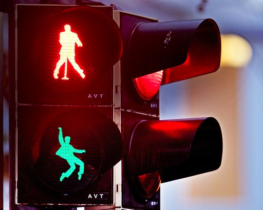 ( AP Photo/Michael Probst). Walking figures depicting late US rock and roll legend Elvis Presley appear on a traffic light switching from green to red in Friedberg near Frankfurt, Germany, Thursday, Dec. 6, 2018. Presley served in Friedberg from Octobe...