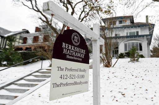 (AP Photo/Keith Srakocic). In this Nov. 28, 2018, photo, a realtor sign hangs in front of a home for sale in Pittsburgh. On Thursday, Nov. 29, Freddie Mac reports on the week's average U.S. mortgage rates.