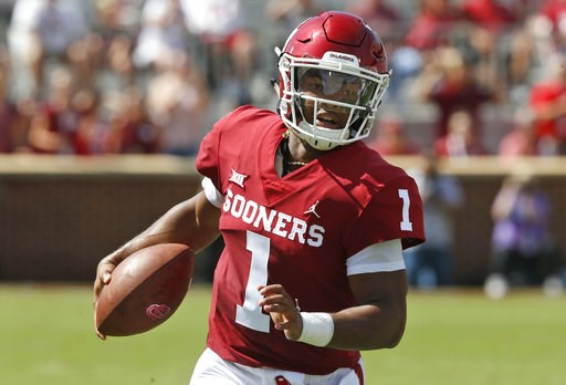 (AP Photo/Sue Ogrocki, File). FILE - In this Sept. 1, 2018, file photo, Oklahoma quarterback Kyler Murray (1) carries the ball in the first half of an NCAA college football game against Florida Atlantic, in Norman, Okla. Murray was named a Heisman Trop...