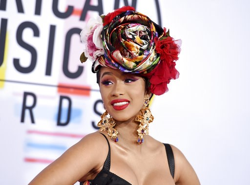 (Photo by Jordan Strauss/Invision/AP, File). FILE - In this Oct. 9, 2018, file photo, Cardi B arrives at the American Music Awards on Tuesday, Oct. 9, 2018, at the Microsoft Theater in Los Angeles. Less than 24 hours after announcing her split from her...