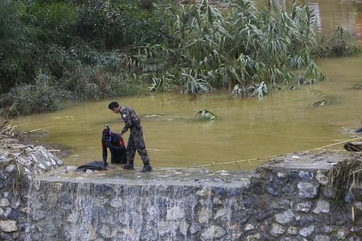 (AP Photo/Petros Karadjias). A diver searches for the body and car of missing people, in the rain flood water near Kerynia city in the Turkish Cypriots breakaway north part of Cyprus, Thursday, Dec. 6, 2018. Police in the breakaway north of ethnically ...