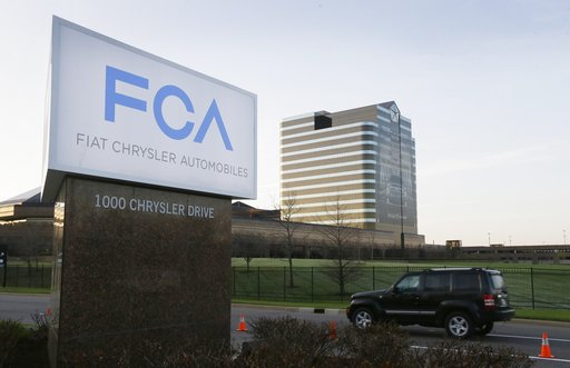 (AP Photo/Carlos Osorio, File). FILE - In this May 6, 2014, file photo, a vehicle moves past a sign outside Fiat Chrysler Automobiles world headquarters in Auburn Hills, Mich. Fiat Chrysler will open another assembly plant in the Detroit area, accordin...