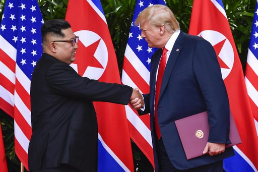 (AP Photo/Susan Walsh, Pool, Fie). FILE - In this June 12, 2018, file photo, North Korea leader Kim Jong Un, left, and U.S. President Donald Trump shake hands at the conclusion of their meetings at the Capella resort on Sentosa Island in Singapore. To ...